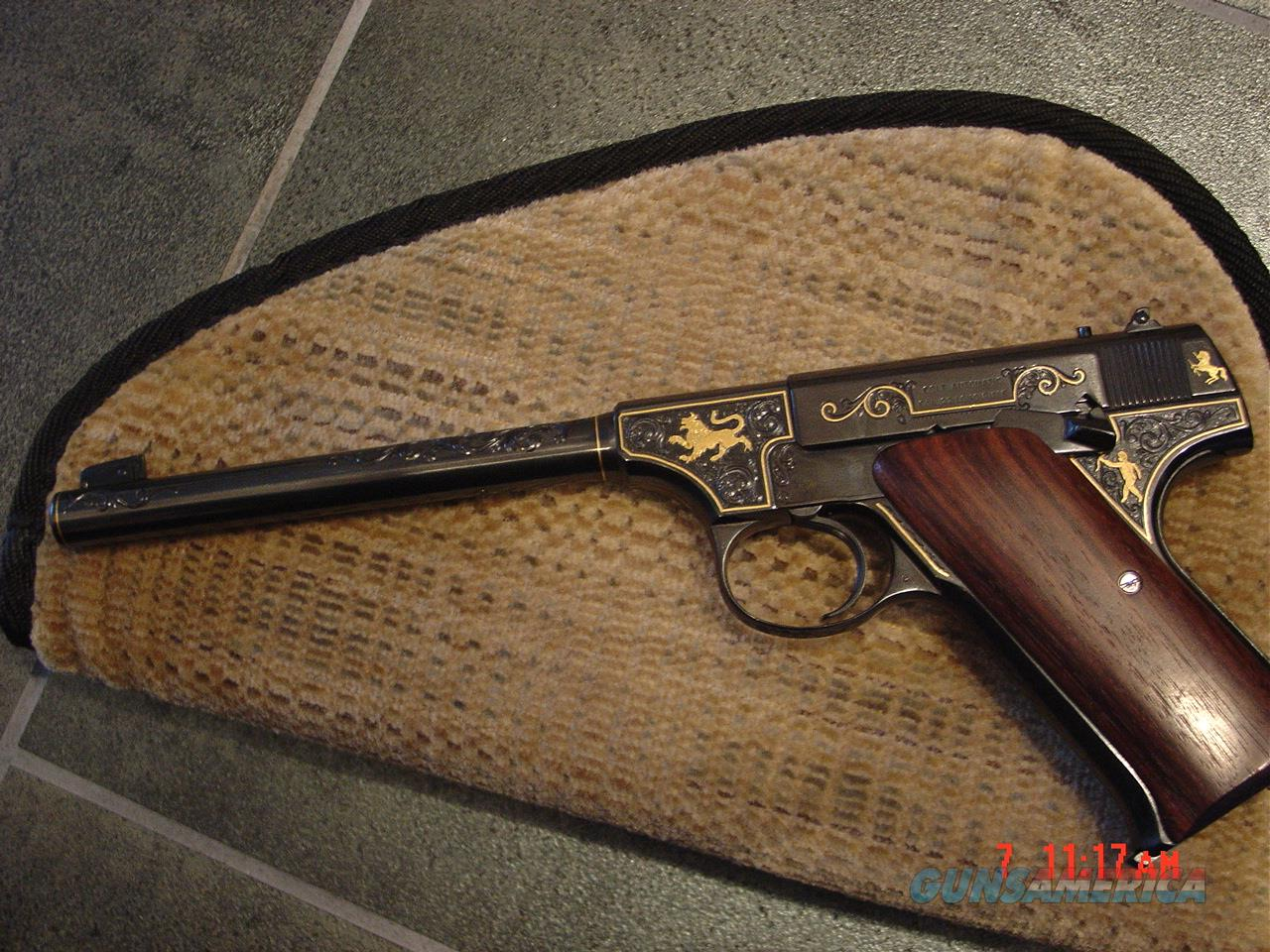 "Colt Pre-Woodsman,circa 1919,fully refinished in high gloss blue with gold accents,master engraved by  Clint Finley,22lr,6 1/2"",an awesome work of art !!  Guns > Pistols > Colt Automatic Pistols (22 Cal.)"