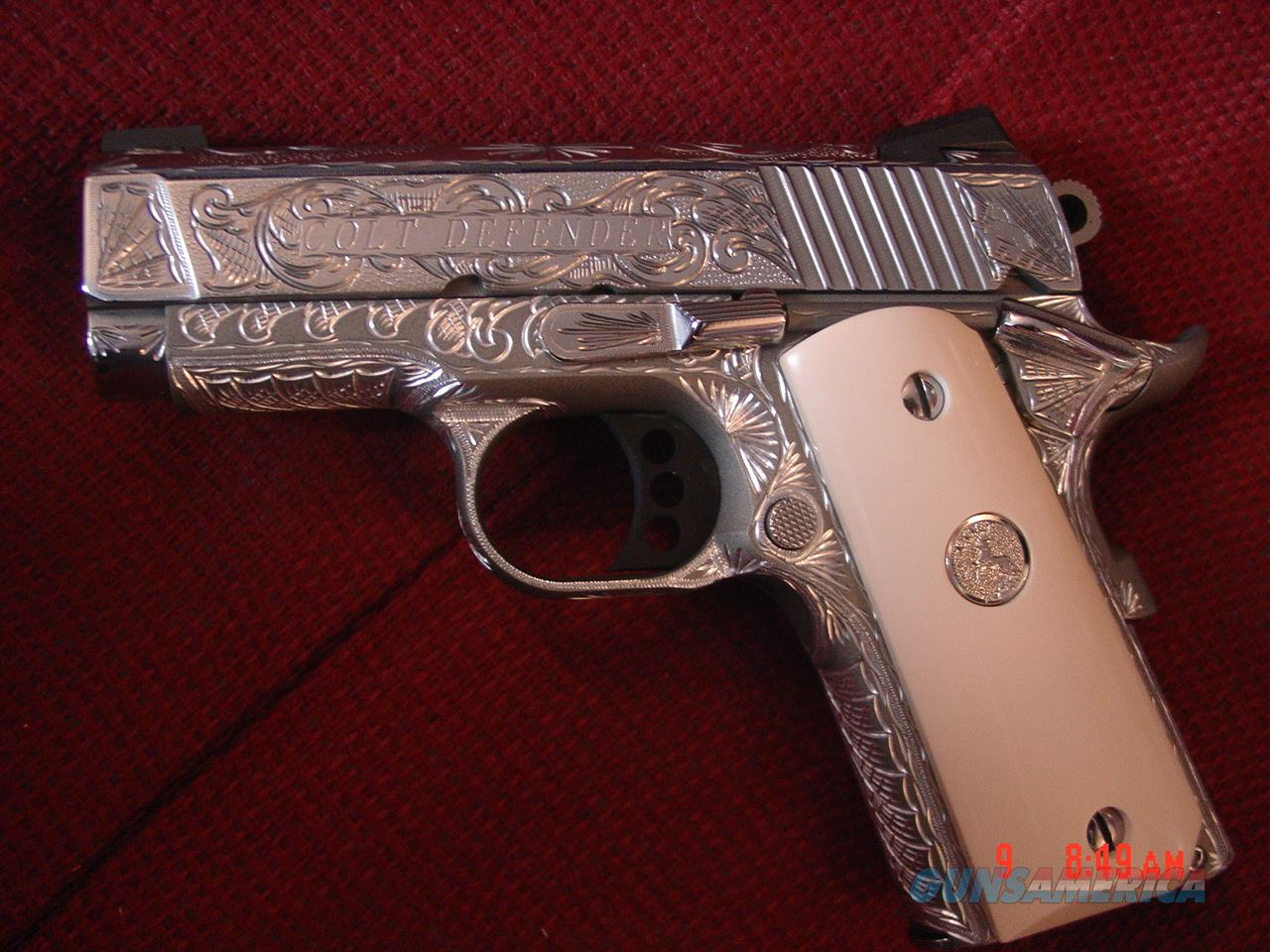 "Colt Defender 45,3"",full deep hand engraved & polished by Flannery Engraving,2 mags,bonded ivory & regular grips, box & certificate. awesome one of a kind work of art !!  Guns > Pistols > Colt Automatic Pistols (1911 & Var)"
