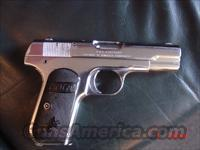 "Colt 1903, 32 ACP,3 1/2""barrel,hammerless,re-finished,nickel,made in 1918-94 years old,soft case,blue magazine,black grips,nice gun for the age  Colt Automatic Pistols (.25, .32, & .380 cal)"