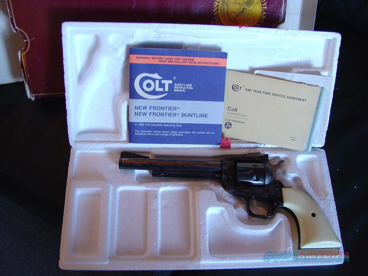 "Colt Kit Carson Commemorative,New Frontier,22LR,6"" barrel,#603 of 951 made in 1984,gold etchings,case hardened frame,faux ivory,original box & manual  Guns > Pistols > Colt Commemorative Pistols"