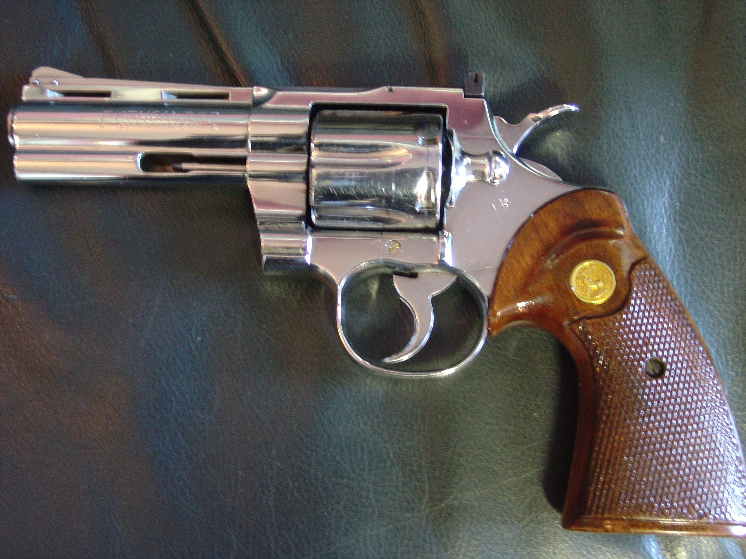 "Colt Python 4"" nickel,357 magnum,1978,adj rear site,wood grips & Hogue rubber,suede zippered case,owners manual,great looking shooter with minor wear   Guns > Pistols > Colt Double Action Revolvers- Modern"