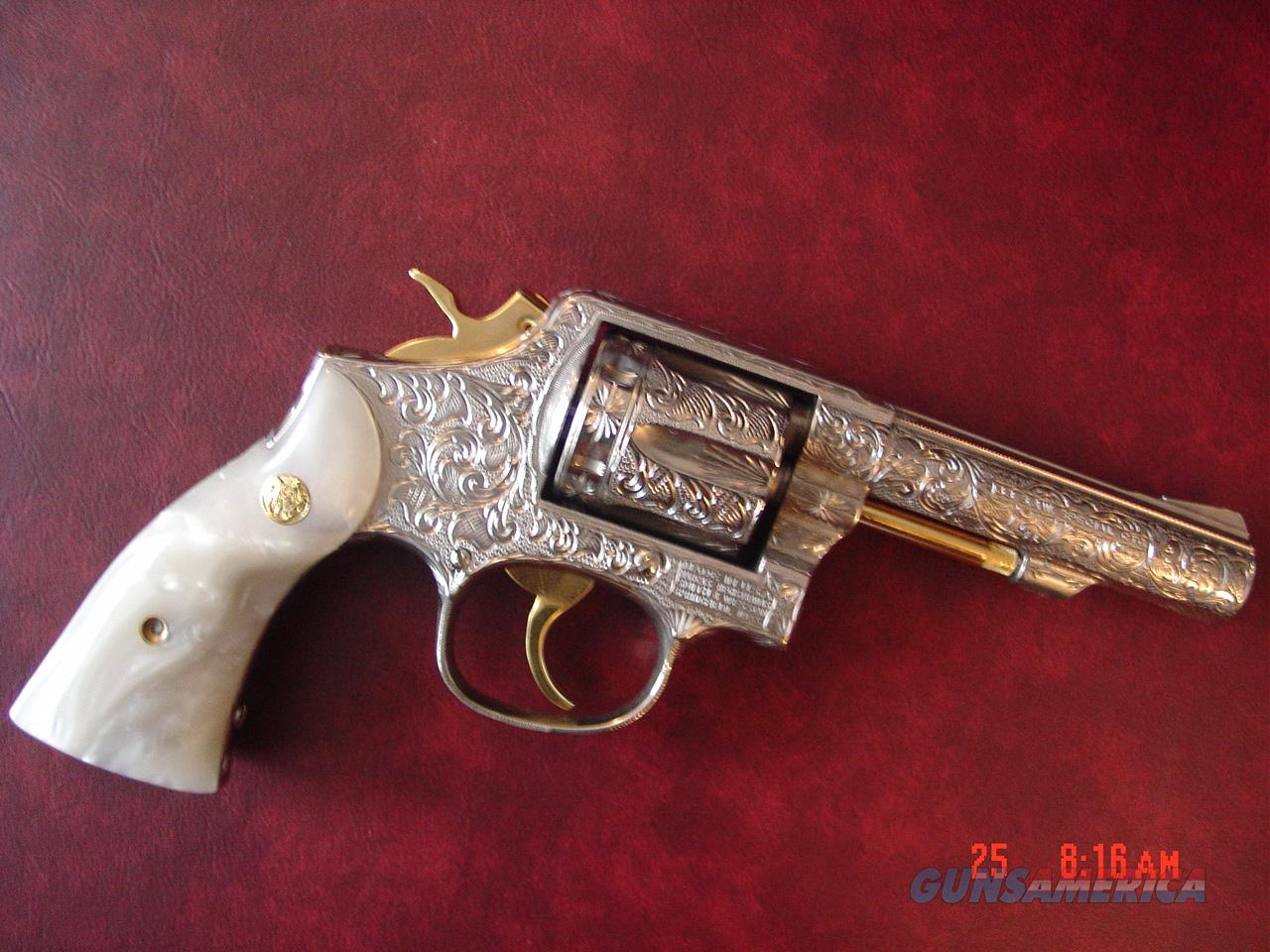 "Smith & Wesson Model 10,4"",38spl.Fully engraved & refinished in bright nickel with 24k gold accents,& Pearlite grips,from Flannery Engraving. much nicer in person ! awesome .  Guns > Pistols > Smith & Wesson Revolvers > Model 10"