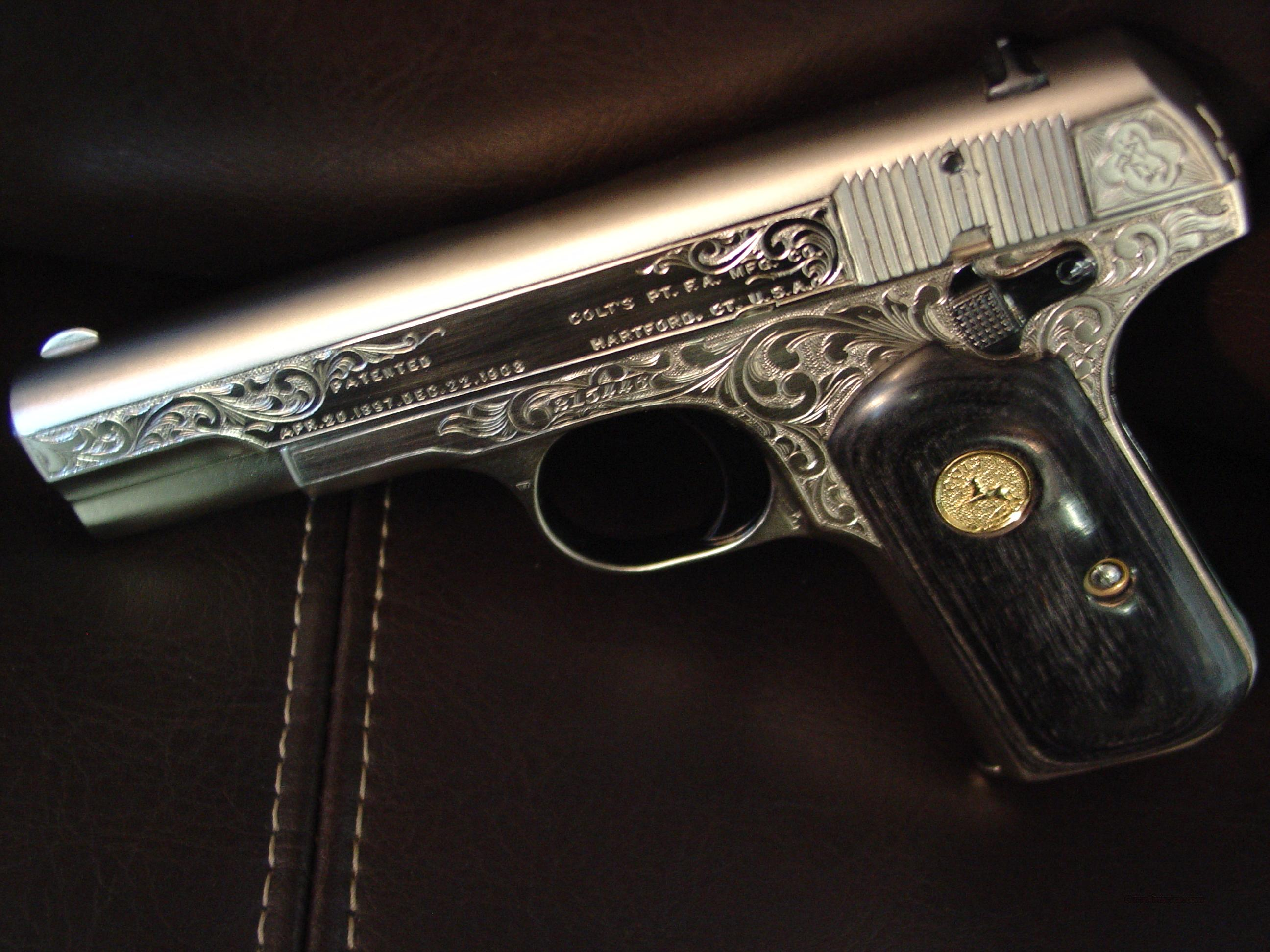 Colt 1903 Hammerless,32 auto,fully refinished in a satin nickel,& deep hand engraved by master engraver S.Leis with certificate,& custom grips,high gloss blued accents, made in 1916-a one of a kind showpiece !!  Guns > Pistols > Colt Automatic Pistols (.25, .32, & .380 cal)