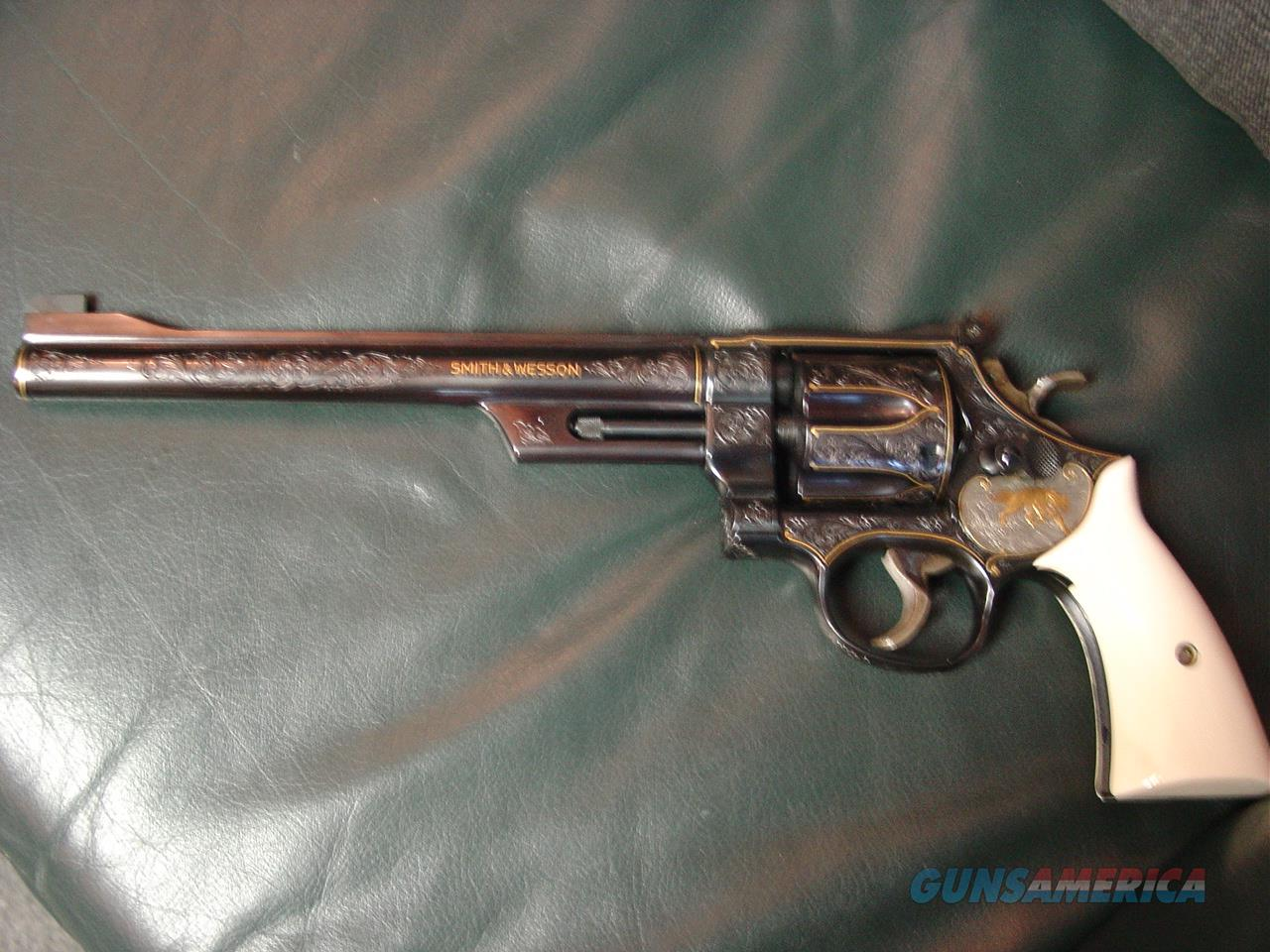 "Smith & Wesson 27-2,signed-Angelo Bee Master engraved,with 24K animals,24k inlays,real ivory grips,8 3/8"",357 magnum,around 40 years old,& photos cant describe this masterpiece enough-awesome one of a kind.  Guns > Pistols > Smith & Wesson Revolvers > Full Frame Revolver"