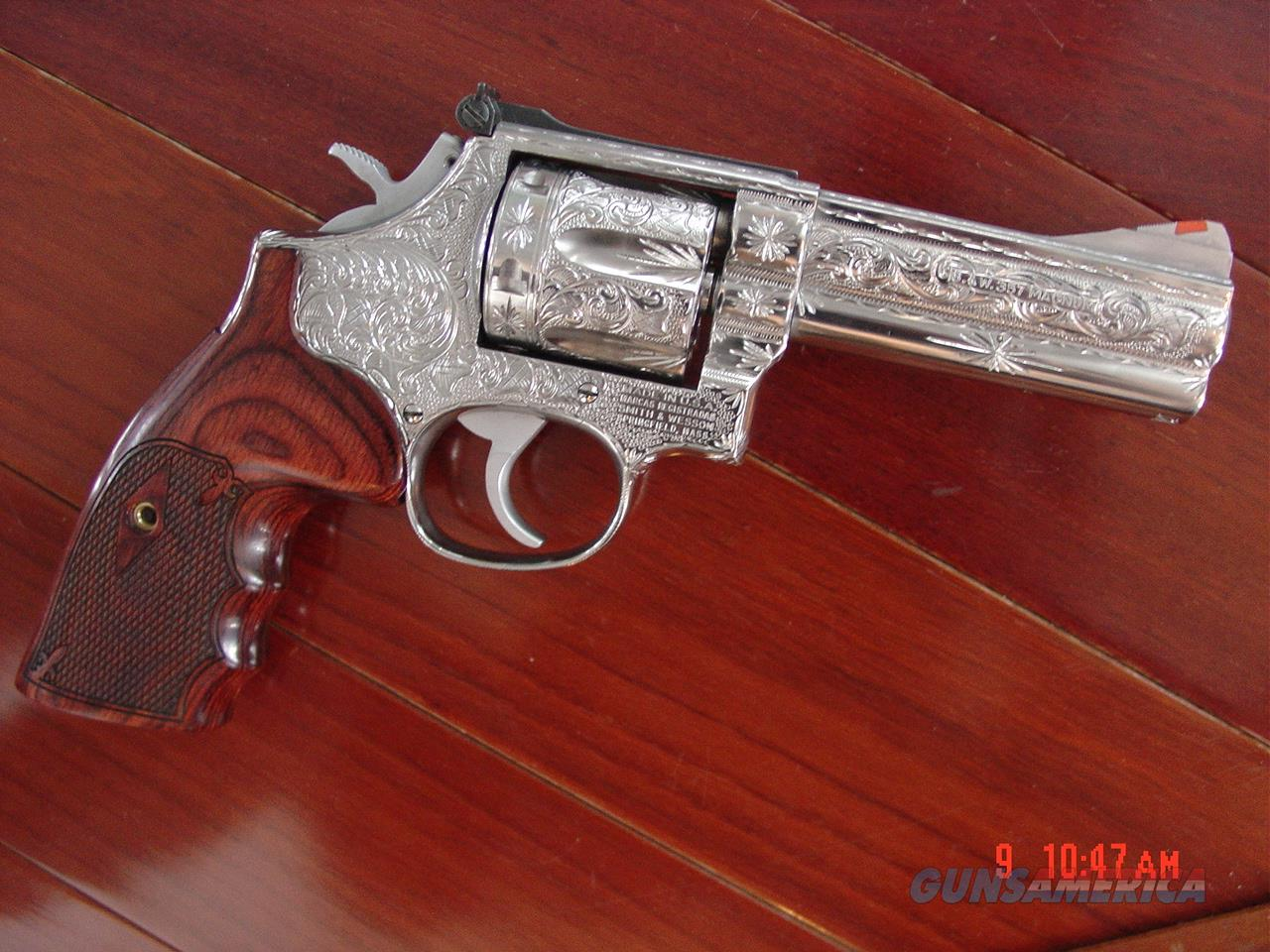 "Smith & Wesson 686,no dash,fully engraved by Flannery Engraving,& polished stainless,custom Rosewood grips,4"" barrel,357 Magnum,adj.site,box & manual,a one of a kind work of art !!  Guns > Pistols > Smith & Wesson Revolvers > Full Frame Revolver"