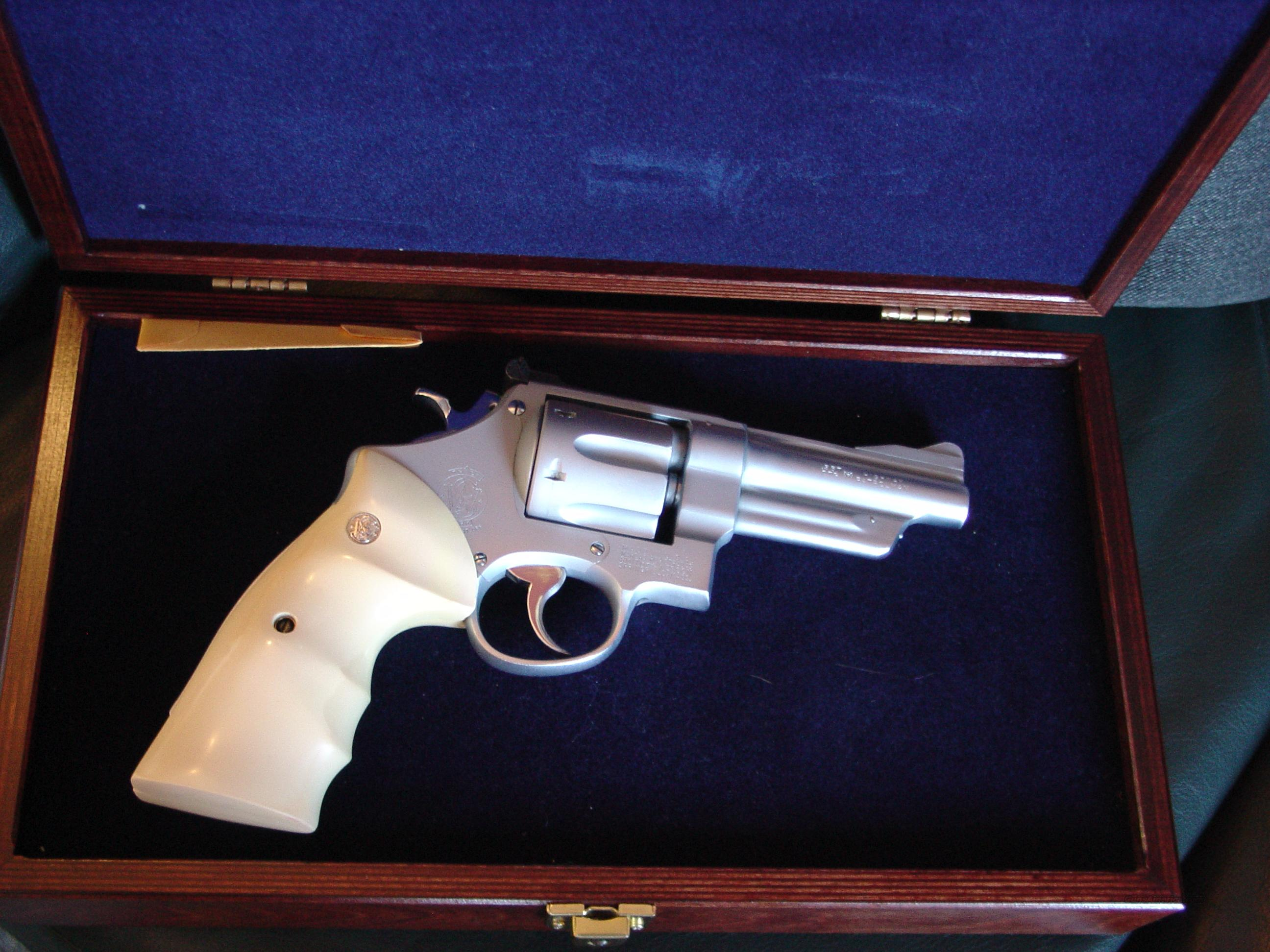 "Smith & Wesson model 28,Highway Patrolman,1956, 5 screws,pinned 4"" barrel,re-finished in a matt nickel look,with bright nickel accents,S&W wood pres case,custom faux ivory grips-very sharp 357 Mag revolver  Guns > Pistols > Smith & Wesson Revolvers > Full Frame Revolver"