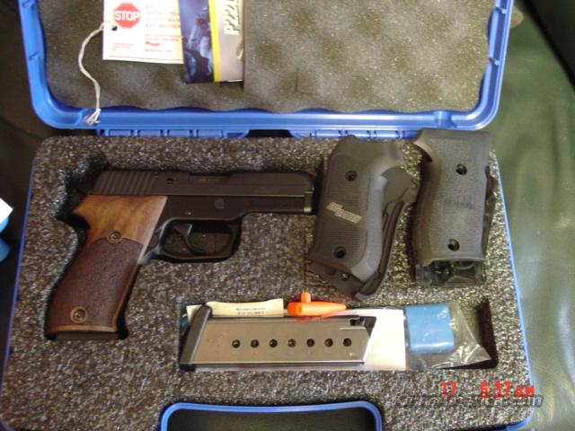 Sig Sauer, P220 SAS,45 acp,blued,3 sets of grips,& new 22LR conversion kit,made in 2009,double action & night sights,box & manual  Guns > Pistols > Sig - Sauer/Sigarms Pistols > P220