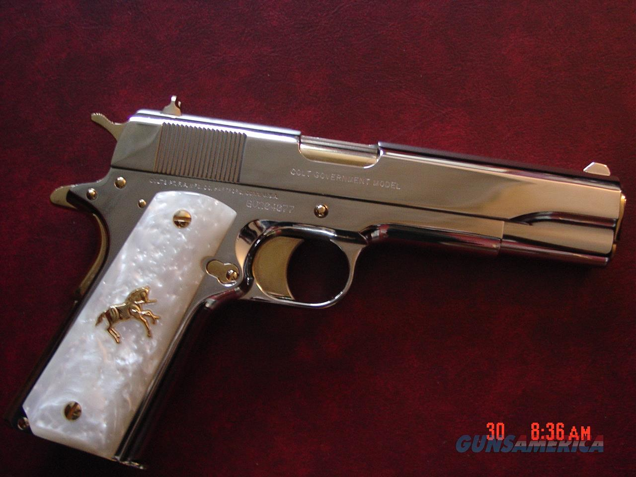 Colt Government 45, full refinished in bright mirror nickel with 24K gold accents,2 mags,pearlite grips,never fired,box,manual etc.an awesome showpiece !!  Guns > Pistols > Colt Automatic Pistols (1911 & Var)