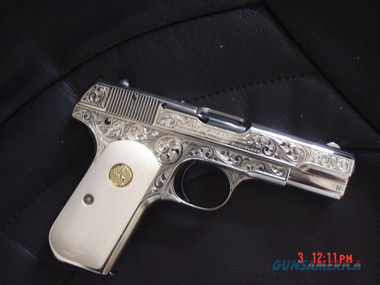 Colt 1903 hammerless,32 cal,Master engraved & refinished nickel w/blue accents,by S. Leis,certificate,bonded Ivory.a true masterpiece work of art !!  Guns > Pistols > Colt Automatic Pistols (.25, .32, & .380 cal)