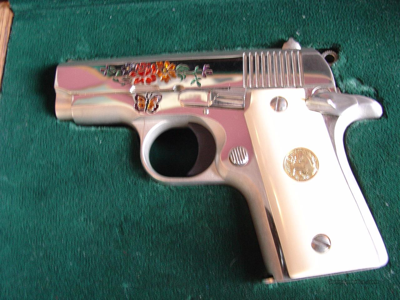 Colt Mustang,380,#48 0f 100,lady Colt engraved deep,with enamel flowes & butterfly & scroll on the other side,high polished stainless,& satin stainless,faux ivory grips,in original Colt fitted prres case. a super beauty & unfired  Guns > Pistols > Colt Automatic Pistols (.25, .32, & .380 cal)