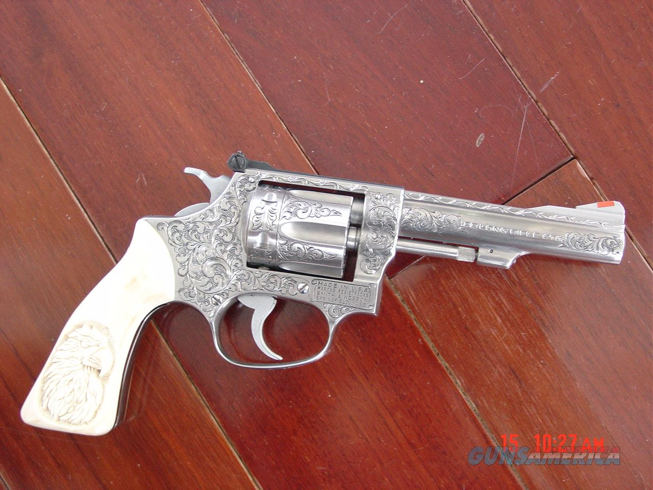 "Smith & Wesson 63 no dash,4"" 22LR,Deep hand engraved by Willy B's customs,real carved ivory grips,box,papers etc..a one of a kind work of art !!  Guns > Pistols > Smith & Wesson Revolvers > Med. Frame ( K/L )"