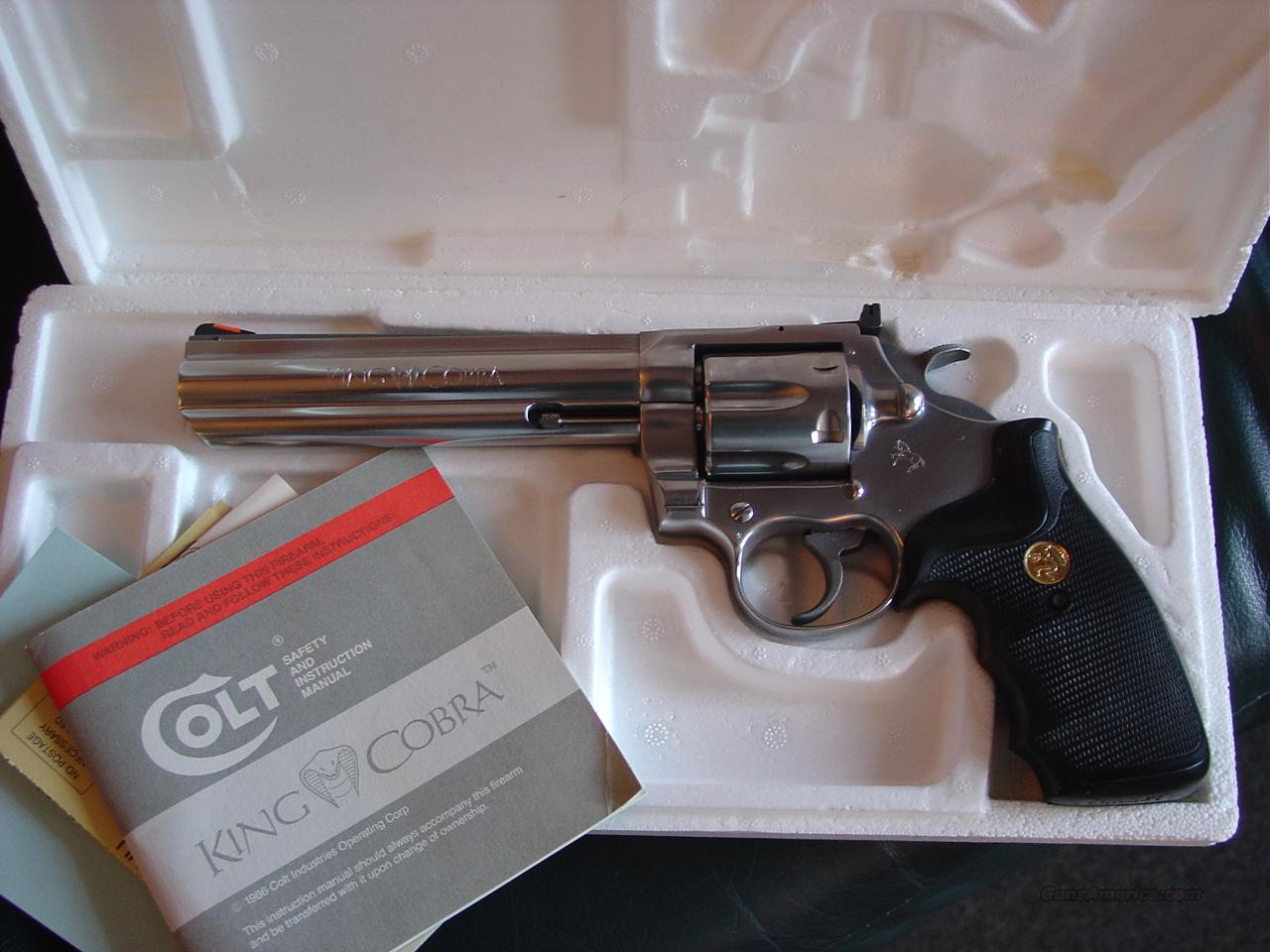 "Colt King Cobra 357 magnum,6"" high polished satin stainless,with serial numbered box,manual etc,1986 on manual-very nice package with Colt medallion grips  Guns > Pistols > Colt Double Action Revolvers- Modern"