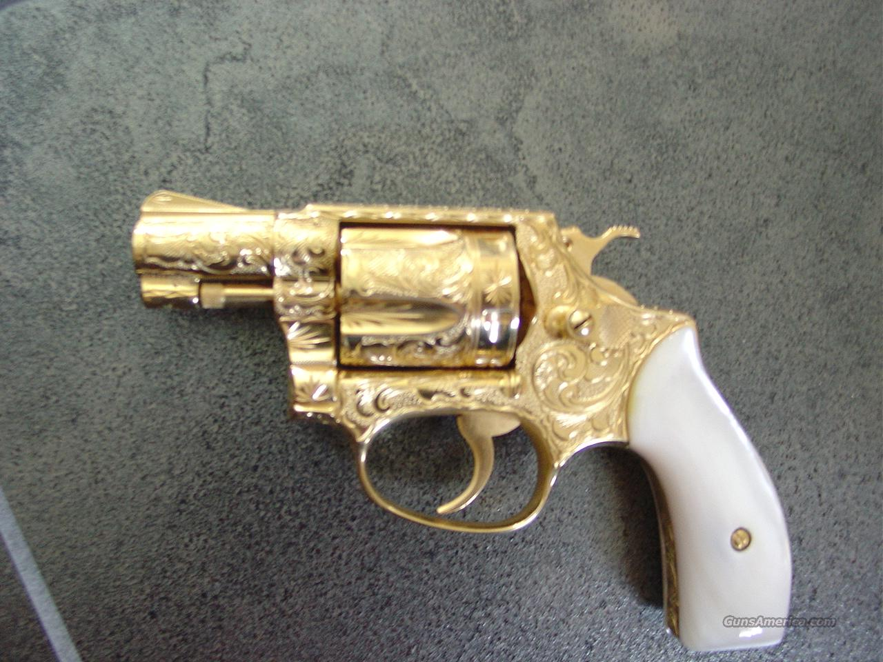 "Smith & Wesson,Model 36 no dash,1 3/4""barrel,24k plated,100%+ master scroll engraved by Jeff Flannery,faux MOP grips,awesome showpiece,38 special  Guns > Pistols > Smith & Wesson Revolvers > Pocket Pistols"