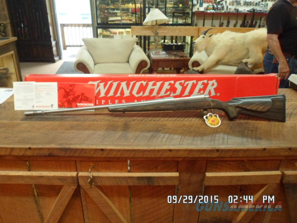 WINCHESTER MODEL 70 (MFG 1998-1999 ONLY) CLASSIC LAMINATED STAINLESS BOSS 300 WIN.MAG DELUXE RIFLE NIB W /PAPERWORK.  Guns > Rifles > Winchester Rifles - Modern Bolt/Auto/Single > Model 70 > Post-64