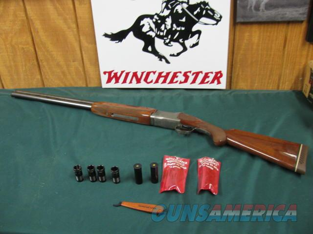 6176 Winchester 101 Pigeon XTR 12 gauge, 28 inch barrels, 6 winchester chokes, 2ic 2mod 2 full, wrench, 2 winchester pouches, freckled right side of receiver. TIGER STRIPED WALNUT, 98% condition.all original and tite.  Guns > Shotguns > Winchester Shotguns - Modern > O/U > Hunting