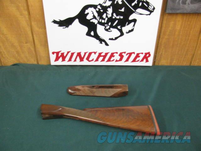 6757 Winchester model 23 GOLDEN QUAIL 20 gauge, factory NEW OLD STOCK,forend/stock with lots of figure AAA++, normally a set of NOS forend/stock set is $500-750.Also from the Winchester factory I have:   23 HEAVY DUCK 12 gamodel 23 grand ca  Non-Guns > Gunstocks, Grips & Wood