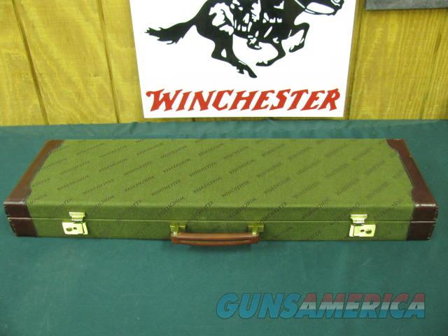 6125 Winchester 101 Pigeon 20 gauge, 26 inch barrels ic/mod,vent rib, ejectors, 14 1/2 lop,Pachmyer pad, rose and scroll engraved coin silver receiver, round knob,AA Fancy Walnut, bores brite and shiny, this shotgun is MINT condition and co  Guns > Shotguns > Winchester Shotguns - Modern > O/U > Hunting