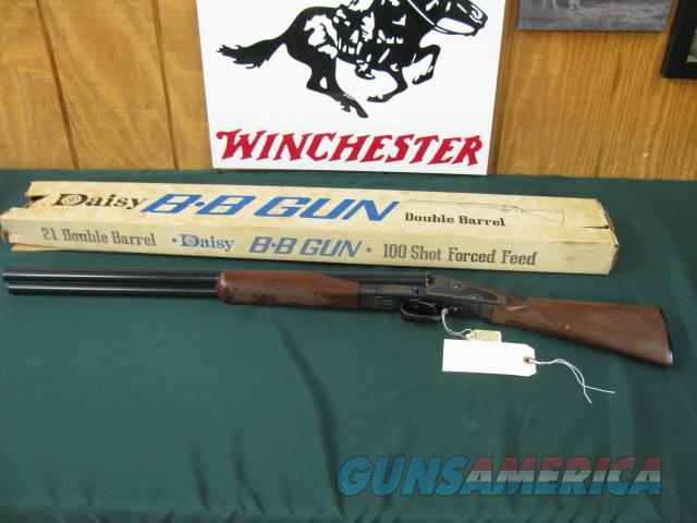6379 WINCHESTER MODEL 21 DAISY BB GUN AS NEW IN BOX , 99% CONDITION WITH CORRECT BOX, GOLD SCROLL WORK AROUND SIDE PLATES AND FRAME. 2 BB LOADING TUBES FOR 96 ROUNDS. I HAVE HAD THIS FOR 30 YEARS IN MY COLLECTION. MFG 1968-72---VERY RARE IN  Guns > Shotguns > Winchester Shotguns - Modern > SxS