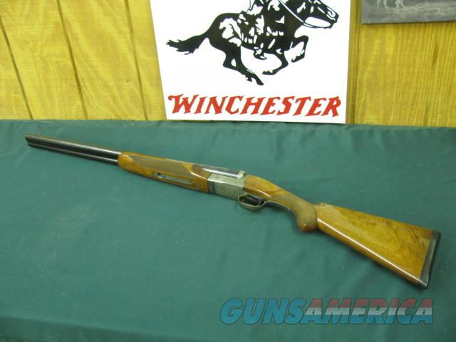 6132 Winchester 23 Pigeon XTR 12 gauge 26 inch barrels,ic/mod, 2 3/4 & 3 inch chambers, vent rib , round knob ejectors,single select trigger, butt pad, TIGER STRIPED FANCY WALNUT, AA++, rose and scroll engraved coin silver receiver. 99% con  Guns > Shotguns > Winchester Shotguns - Modern > SxS