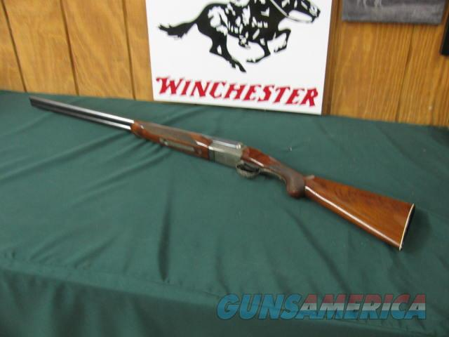 6569 Winchester 23 Pigeon XTR 20 gauge, 28 inch barrels,mod/full, 2 3/4 & 3 inch chambers, round knob, ejectors, vent rib, Winchester butt plate all original, 98% or better condition, snap caps, coins silver rose and scroll engraved receive  Guns > Shotguns > Winchester Shotguns - Modern > SxS