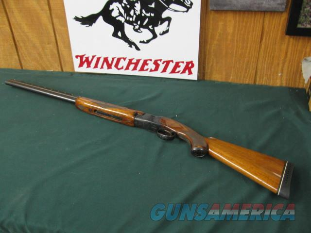 6644 Winchester 101 field 20 gauge 2 3/4 & 3 inch chambers, ic/mod, vent rib, ejectors, pistol grip with cap,ported, White line pad lop 14, 97%-98% condition. opens and closes tite, bores brite/shiny, hard to find in 26 inch barrels with ic  Guns > Shotguns > Winchester Shotguns - Modern > O/U > Hunting