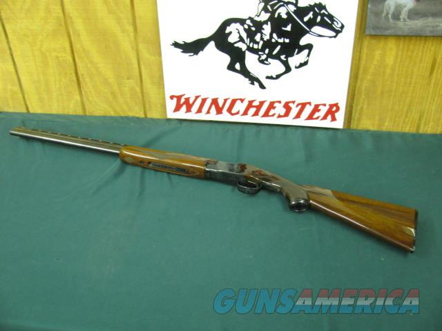 6079 Winchester field 28 gauge 26 inch barrels, ic/mod, vent rib, pistol grip with cap, ejectors,Winchester butt pad, ALL ORIGINAL, shot little, opens and closes tite, bores brite and shiny,one of a pair with #6080 the 410,both bought from   Guns > Shotguns > Winchester Shotguns - Modern > O/U > Hunting