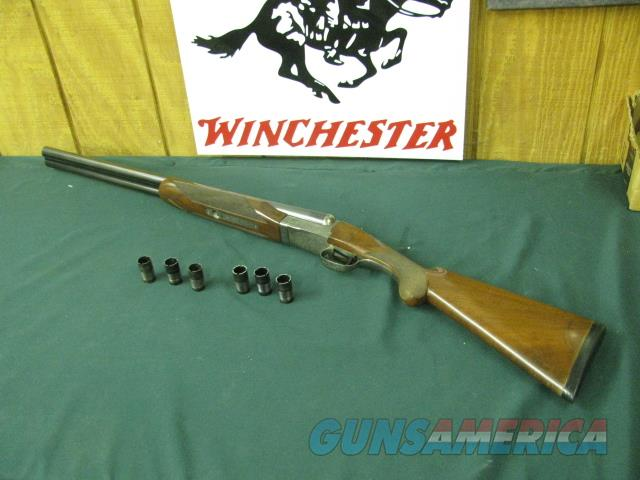 6593 Winchester 23 Pigeon XTR 12 gauge 26 inch barrels 6  flush winchokes, s, ic, m,im,f,xf, round knob, vent rib, ejectors , original Winchester butt pad, coin silver rose and scroll engraved receiver,small crack by receiver. single select  Guns > Shotguns > Winchester Shotguns - Modern > SxS
