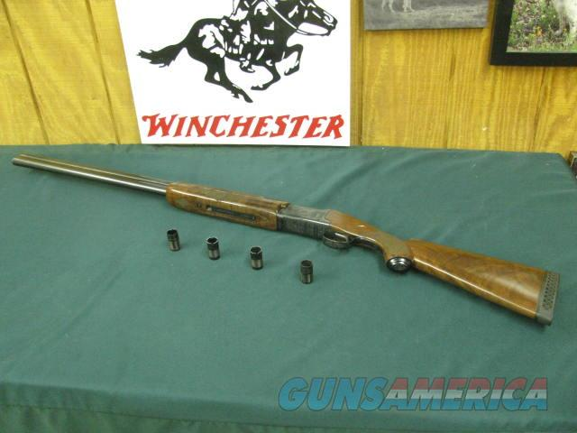 6926 Winchester 101 Waterfowler 12 gauge 30 inch barrels, 4 winchokes ic,2 mod,xf,pistol grip with cap Winchester butt pad,all original, 99% condition, not a mark on it. ducks/geese engraved on blue receiver. hard to get, A++fancy walnut.  Guns > Shotguns > Winchester Shotguns - Modern > O/U > Hunting
