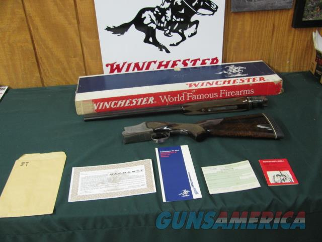 6596 Winchester Pigeon 12 gauge 26 barrels, ic/mod, ejectors, vent rib,pistol grip, butt pad, lop 14.5, correct serialized Winchester box, all papers, AAA++FANCY WALNUT IN STOCK AND FOREND-SOME OF THE FANCIEST SEEN,THIS IS THE EARLY ONE WHE  Guns > Shotguns > Winchester Shotguns - Modern > O/U > Hunting
