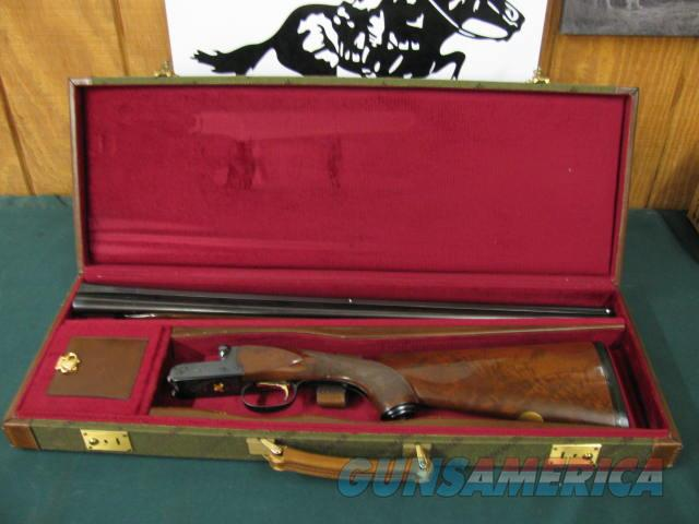 6326 Winchester 23 Classic 28 gauge 26 inch barrels ic/mod BABY FRAME, vent rib pistol grip with cap Winchester butt pad,ejectors, AA+Fancy Walnut stock/forend. GOLD RAISE RELIEF QUAIL on bottom of receiver, only 900 mfg this is # 705. open  Guns > Shotguns > Winchester Shotguns - Modern > SxS