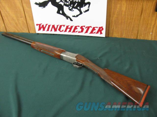 6365 Winchester 101 Pigeon XTR FEATHERWEIGHT 12 gauge 26 inch barrels ic/Im,STRAIGHT GRIP, all original, AA Fancy figured walnut,coin silver quail and pheasants engraved receiver, vent rib, ejectors, 99% condition on of the best i have had.  Guns > Shotguns > Winchester Shotguns - Modern > O/U > Hunting