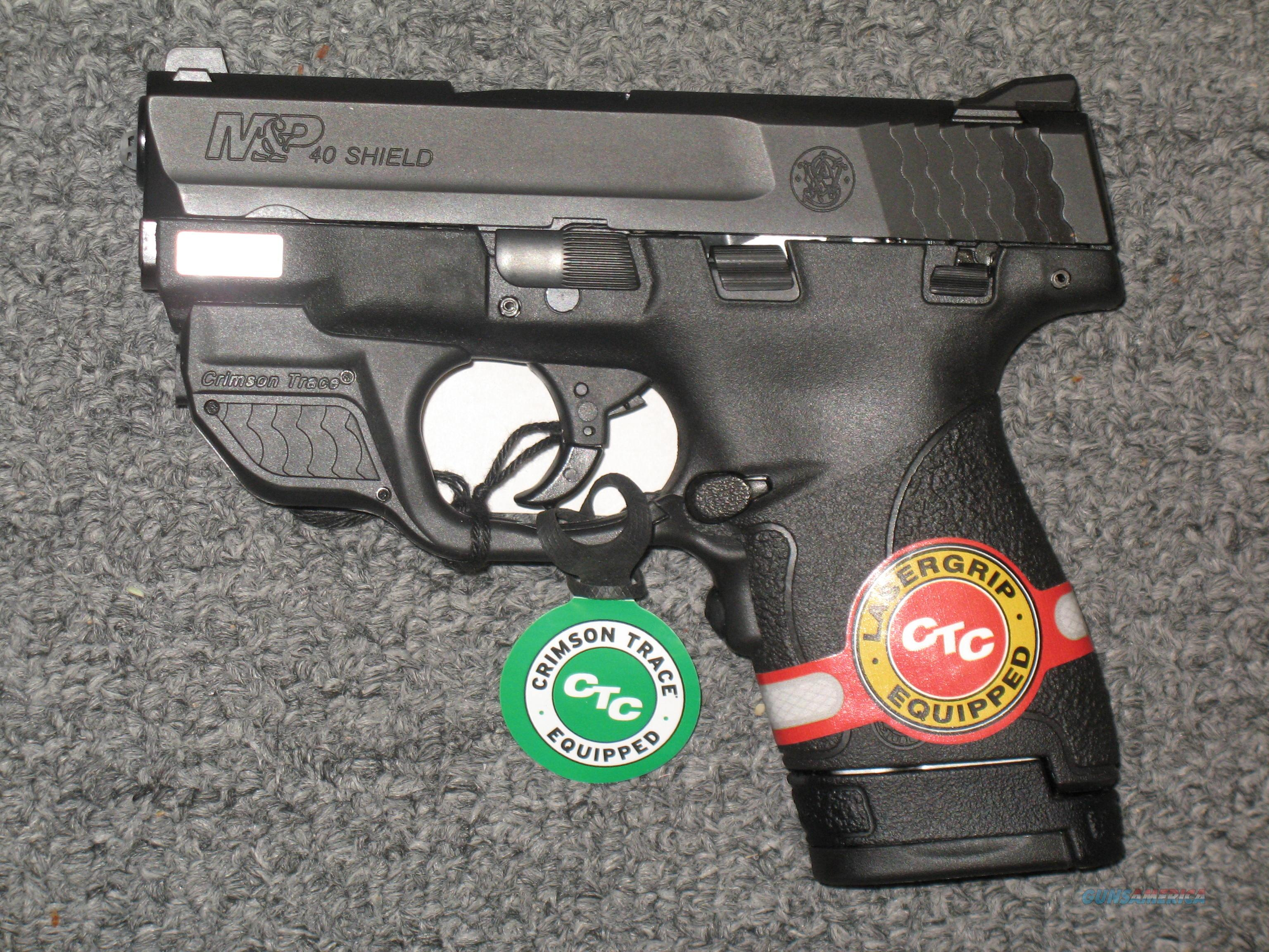 Smith & Wesson M&P40 Shield (with green Crimson Trace laser)  Guns > Pistols > Smith & Wesson Pistols - Autos > Shield