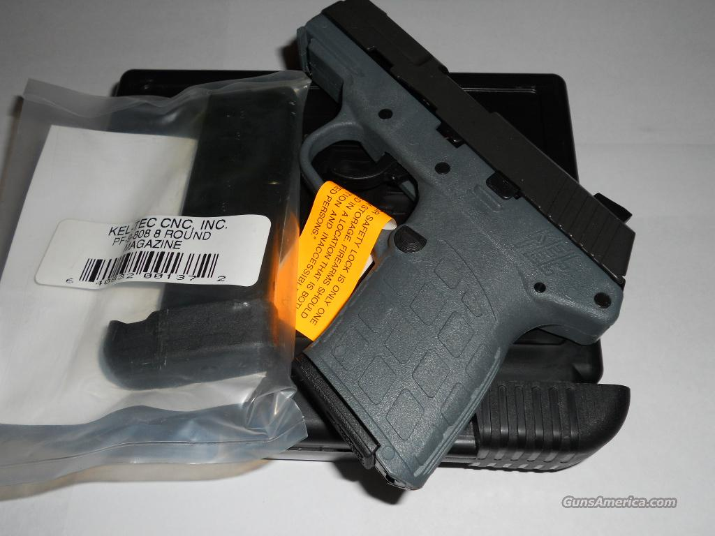 Kel-Tec Parkerized/Gray Grip PF-9 with 7 and 8 Round magazines.  Guns > Pistols > Kel-Tec Pistols > Pocket Pistol Type
