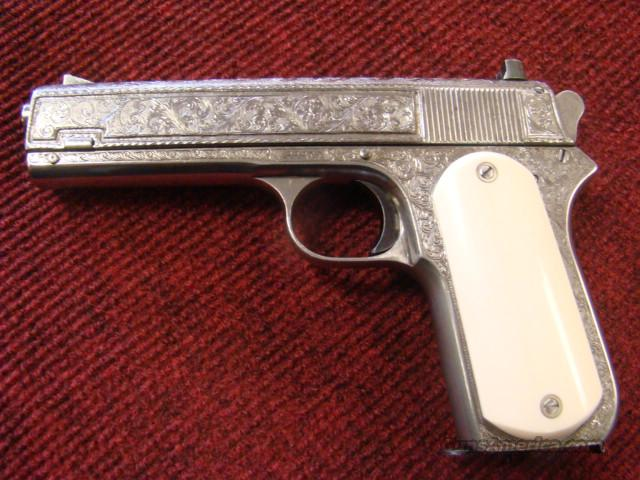 ENGRAVED COLT MODEL 1903 HAMMER POCKET MODEL WITH IVORY GRIPS 38 AUTO CAL  Guns > Pistols > Colt Automatic Pistols (.25, .32, & .380 cal)