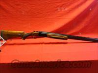 WEATHERBY ORION 12 G  Weatherby Shotguns > Hunting > O/U