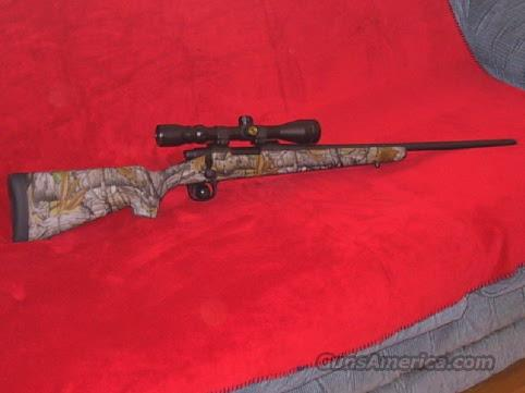 REMINGTON 700 ADL 7mm-08 CALIBER IN SKYLINE EXCEL CAMO WITH 3X9X40mm SCOPE