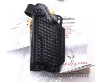 Safariland Duty Holster SSII Glock 17 22 GTL Light Left Hand Shooter 6280837 Safari-Laminate Black Basketweave 2 1/4 inch Slots Tactical Light Unissued with Spacer for Pistols without Lights also fits models 19 & 23  Non-Guns > Holsters and Gunleather > Large Frame Auto