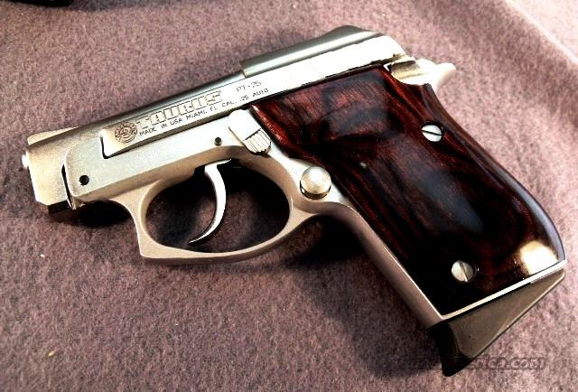 Taurus # 1250035R, .25 ACP Model PT-25 Auto Nickel finish with Rosewood Grips NIB Beretta 21A Tip-Up Competitor.   Guns > Pistols > Taurus Pistols/Revolvers > Pistols > Steel Frame